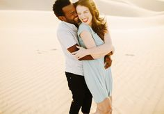 this couple met in an African desert and got engagement pictures taken in a desert as a tribute to their story! they are so cute!