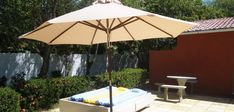 There is loads of outdoor furniture on the terrace of Casa Caju, towels and sunshade are provided.