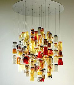 "This light sculpture is built using found 'Salvation Army"" drinking glasses,"
