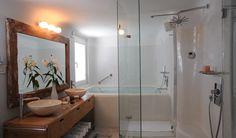 Nice deep tub, big shower, bowl sinks