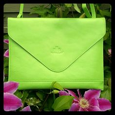 Convertible cross-body\clutch Super cute in spring green! Envelope style with back compartment.  Comes with protective bag.  Magnet close. Used only a few times. adjustible strap: can be worn as cross body or over the shoulder, or simply remove for an envelope clutch! One of my FAVES ->fits lipstick, smart phone, credit cards, cash, and even my bronzer and blush! With room to SPARE! Hard to part with!  Measurements        L:  10.5 in.        H:       8 in. Rowallan Bags Clutches & Wristlets