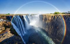 An almost full-circle rainbow, seen at the Zambian side of the Victoria Falls  Image credit: Nicole Cambre / Rex Features