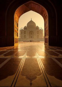 I love this photo do the Taj Mahal because it's not the typical photo you see of the Taj Mahal (Taj Mahal and it's reflection). I also love how the arch around the Taj Mahal immediately draws your eye to the building. Places Around The World, Oh The Places You'll Go, Places To Travel, Places To Visit, Around The Worlds, Taj Mahal India, Wonderful Places, Beautiful Places, Beautiful Pictures