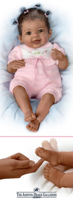 Handcrafted lifelike interactive baby doll by Linda Murray wiggles her feet when you tickle them. Poseable, with hand-painted features, knit romper.