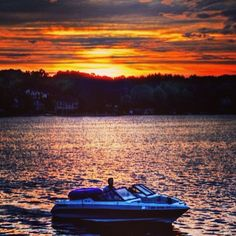 Sunset and boat over Apple Valley Lake