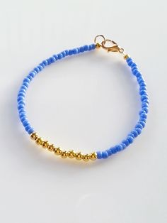 This wonderful friendship bracelet is made with periwinkle blue and gold beads. A beautiful and gentle color combination looks great and can be stacked with other beaded bracelets for a layering effec