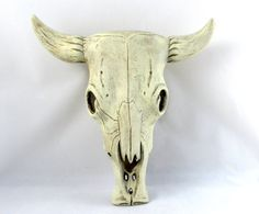 Great decor piece for your garden or for that country feel. Ceramic hand painted cow skull. This piece can be hung on a wall or simply displayed