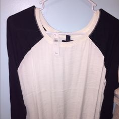 Brand new with tags! Women's top from Gap size L Bought this for my daughter and I discovered it in her closet about a month later with tags still on. This is a large, off white center with black sleeves. Slightly gathered at waist. Very light-weight and comfortable! GAP Tops Tees - Long Sleeve