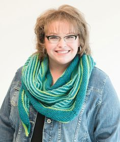 Marly's Garter Stitch Shawl - Start at the center top and knit your way down to the point. As you go you will be changing stitches and colors and creating the perfect striped shawl. Choose any three shades of yarn to tailor the colors to your own look and style.