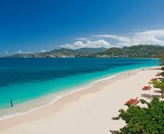 Be caressed by cool sea breeze while you bask on 2 miles of white sand...Grand Anse Beach