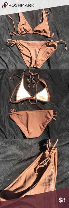 "The ""EVERYDAY"" bikini This is a simple brown string bikini with clear gel polka dot accents.  The bottoms tie on both sides at the hips for adjustable fit for comfort.  The top is a medium and bottoms a small. ( I wear a size 34C top and 0-3 bottom).  Worn only a few times and still in perfect condition.  Smoke free home Xhilaration Swim Bikinis"