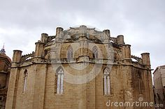 Photo about This is the back of an old cathedral showing the east end of the radiating chapel around the ambulatory with decorative mini flying buttresses. Image of spanish, amposta, east - 80326976 Flying Buttress, Travel Europe, Mount Rushmore, Cathedral, Spanish, Stock Photos, Mountains, Architecture, Mini