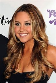 warm honey brown base color with some soft toffee highlights that softly flow through her hair.