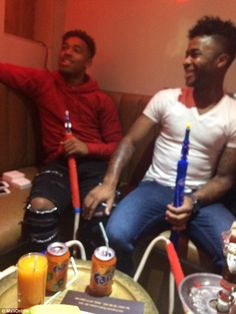 Liverpool players Raheem Sterling and Jordon Ibe have been pictured smoking a shisha pipe ...