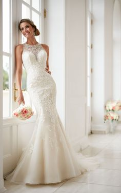 This elegant high neck wedding dress with lace beading from Stella York is an impressive fit-and-flare made for a stunning bridal moment.