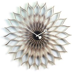 Vitra Sunflower Wall clock ($1,075) ❤ liked on Polyvore featuring home, home decor, clocks, brown, vitra, vitra clock and brown wall clock