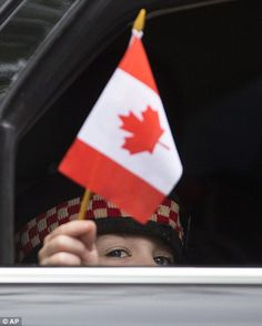 Saddest day: Marcus Cirillo, son of Cpl. Nathan Cirillo, looks out from a car window as family members leave the funeral of his father in Hamilton, Ontario, on Tuesday, October 28, 2014