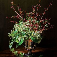 Sculptural and Organic Arrangement: Bush ivy + buckthorn berry branches + variegated pittosporum + ivy