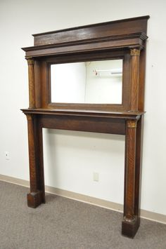 *** IMPORTANT SHIPPING INFORMATION PLEASE READ*** - IF THE SHIPPING COST IS INDICATED AS $0 OR FREE, SHIPPING IS NOT INCLUDED IN THE ITEM PRICE. - THERE IS AN ADDITIONAL COST FOR SHIPPING - MESSAGE US WITH YOUR ZIP CODE FOR A SHIPPING QUOTE  ___________________________________________________  Item: Antique Tiger Oak Fireplace Mantel Surround with Central Mirror  Details: Tall Stately Form, Upper Mirror, Beautiful Wood Grain, Column Supports with Applied Carved Capitols, Authentic Antique…
