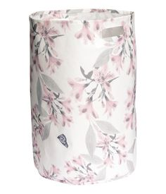 Cylindrical laundry basket in thick polyester with two handles and plastic coating inside. Size 13 1/2 x 20 1/2 in.