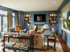 """This style is a bit too traditional, but I like the mix of colors, textures, and the seating arrangement. Also like the console table behind the sofa - giving you an opportunity to make the space more """"homey"""" (to add family pictures, etc)"""