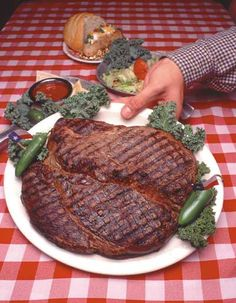 Big Texan Steak Ranch, home of the free 72oz steak...IF you eat the whole thing within the allotted time.  On I-40 near Amarillo, Texas