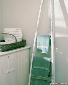 Towel Ladder - Keep the bathroom tidy by hanging towels from the rungs of a progressive or apple-picking ladder propped against a wall. Or use a towel ladder on a porch for beach towels, so sand isn't brought indoors. To prevent the ladder from slipping, attach rubber tips made for chair legs to the ladder's feet. You can also secure the top of the ladder to the wall with hooks and eyes.