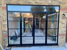Heritage doors with slimline bars inside the glass, French doors with a fixed top and side panel to complete the rear glazing look Aluminium Glass Door, Aluminium French Doors, Upvc French Doors, Glass French Doors, Fence Doors, Sliding Patio Doors, Folding Doors, Back Doors, 1930s House Extension