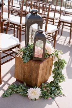 Love this aisle decor: lanterns. wooden boxes. garland. Photography by picotteweddings.com