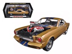 1965 Ford Shelby Mustang GT 350R Gold/Blue 1/18 Diecast Car Model by Shelby Collectibles - Brand new 1:18 scale diecast 1965 Ford Shelby Mustang GT 350R Gold/Blue die cast car model by Shelby Collectibles. Has steerable wheels. Brand new box. Rubber tires. Has opening doors and trunk. Made of diecast with some plastic parts. Detailed interior, exterior, engine compartment. Dimensions approximately L-10, W-4, H-3.5 inches. Please note that manufacturer may change packing box at anytime…