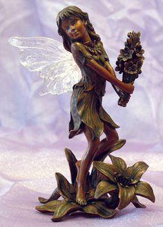 Little Fairy Holding Flowers