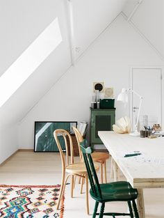 all white attic workspace with moroccan boucherouite rug