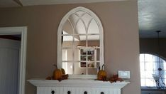 Bring a little bit of old European charm into your home with this unique cathedral window mirror. Standing 37 tall x 24 wide x 1 deep, this is the perfect hanging wall accent or standing mantel piece. Our frames include 2 layers --- an interior layer of window grids which are all beveled at 60