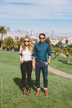 Portrait of hipster couple standing in city park by Trinette Reed #stocksy #realstock