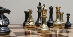 Grand Master brass set, very heavy and substantial yet attractive 34 piece set of chess men with extra queens
