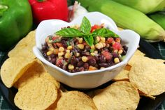 Four Layer Rum BeanDip: Bean dip is such a delicious way to snack, especially during action-packed Super Bowl parties. It's one of those snacks with fewer calories, but very filling. What happens when you add a little rum to that? Oh, you'll see! http://hellobeautiful.com/playlist/superbowl-food-recipes/item/2697294
