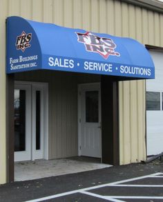 Vinyl Awning With Colorful Logo Applied To Front And Side Edges Waterfall Style Entrance Door
