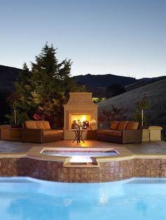 Fireplace and outdoor hangout next to the pool Sizzling Style: How to Decorate a Stylish Outdoor Hangout with a Fireplace