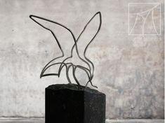 Stainless steel thread figure of a bird with a worm in its beak, placed on a bluestone pedestal. Marcel, Worms, Craftsman, Stainless Steel, Bird, Pedestal, Artist, Black, Design