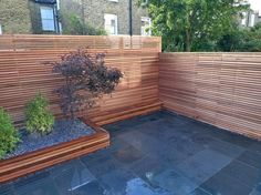 Garden Decor With Garden Designer Modern Design Features Backyard Ideas A Black Ceramic Flower Pots Wooden Walls Of Plants And Small Trees of Amazing Modern Garden Design To Beautify Your Lovely Home from Exterior Ideas
