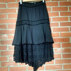"Witchy Woman H&M Bohemian Skirt Black h&m skirt with tiers and black crochet lace. Back zip. Really unique pretty details. Size 4. Doesn't have stretch. Def best for 2/4 Very minor flaws and wear to the fabric and trims. No holes or stains. Lots of ways to style this romantic beauty. Shown on 5'8"" size small. Tags: free people, forever 21, vintage, boho No trades. H&M Skirts Asymmetrical"