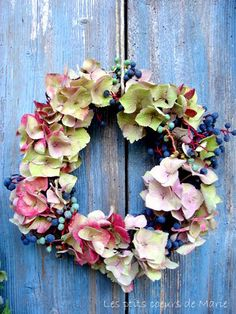 Love it!!! Who would of thought of an orchid wreath how beautiful. Would do different colors but awesome idea :)