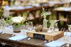 Small pallet, logs and clear vases filled with fresh flowers - Cedarwood is the Nashville Wedding Venue for Country Romance | Historic Cedarwood | All Inclusive Designer Weddings