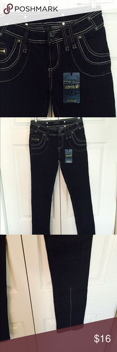 OTB Stretch Skinny sz 7/8 NWT Darkest Blue OTB skinny jeans with contrast stitching.  2 front plus small zipper pocket, 2 back pockets.  Back seam below knee for interesting detail.  55% ramie 20% cotton 24% poly 1% spandex.  New with tags!! OTB Jeans Skinny