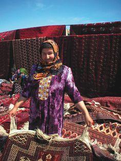 A women selling carpets in the Talkouchka Market, just outside of Ashgahbat, Turkmenistan