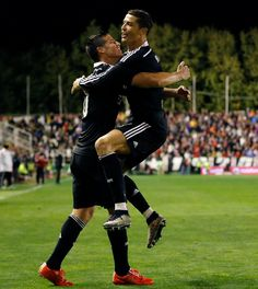 James Rodríguez of Real Madrid CF celebrates with teammate Cristiano Ronaldo after scoring their second goal during the La Liga match between Rayo Vallecano de Madrid and Real Madrid CF at Vallecas Stadium on April 8, 2015 in Madrid, Spain.