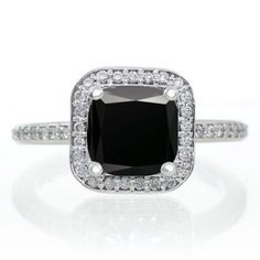 Princess Cut Black Diamond Classic Halo Engagement Ring. The vintage Black Diamond and diamond bridal wedding ring set for woman is now available at sale price for limited time. The order comes with free shipping. Give her the perfect Black Diamond and diamond engagement ring set.