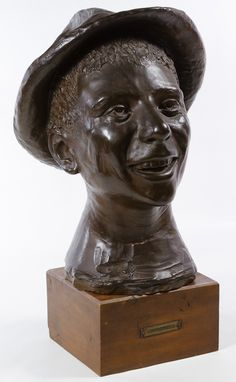 "Lot 387: Renato Bertelli (Italian, 1900-1974) ""Contradinello"" Sculpture; Undated, signed en verso, title plaque on wood mount, depicting a smiling male bust wearing a hat; made of clay with a bronze style glaze"