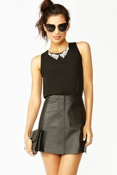 Tiered crystal top & high waisted leather skirt.