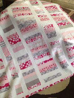 Beautiful pink, white and gray quilt for my niece.